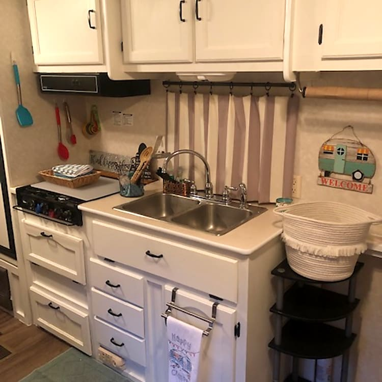 Kitchen area with provided cooking necessities if wanted