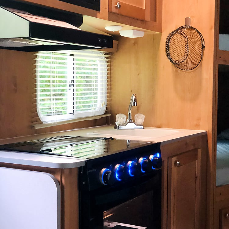 Electric microwave, propane stove top and oven.