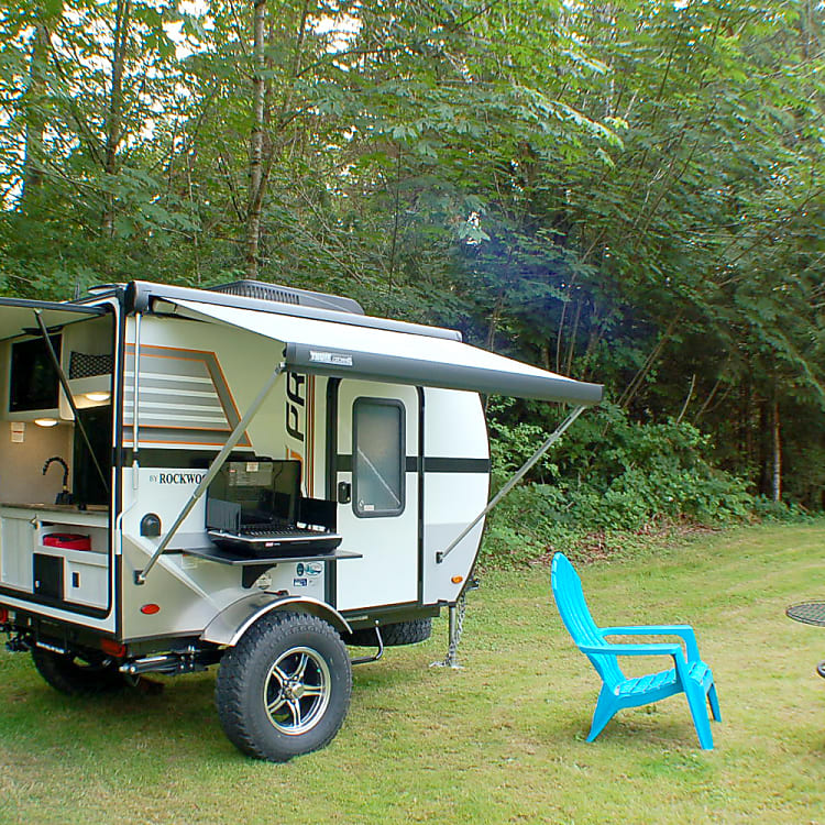 Covered exit and kitchen to stay dry in those dewy mornings! Coleman stove for cooking.