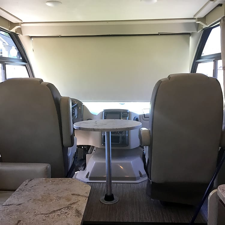 Removable table between driver and passenger seats. Seats turn to face inward.
