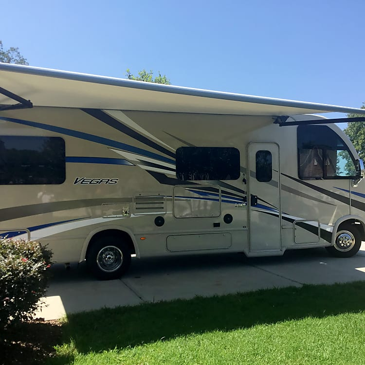 Large power awning with outdoor tv.
