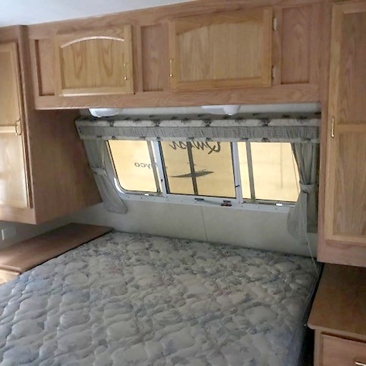 Master bedroom at front of trailer. Bed lifts up for additional storage.  Storage all around.