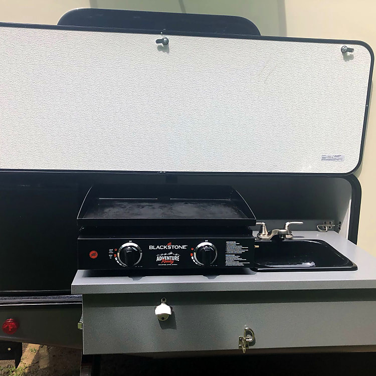 Outdoor kitchen and fridge. Blackstone griddle available to rent with accessories. Game-changer!