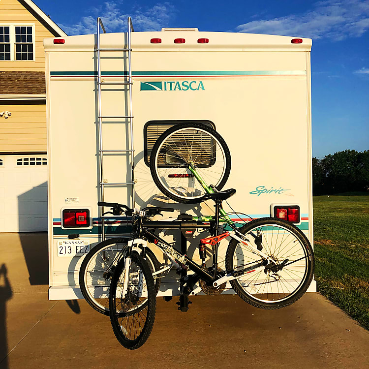 Example of bike rack loaded.  Bike rack is an ad on; bikes are not included. One bike mounts upside down.  We will include a chair rack on the ladder to hold chairs if you'd like to use it.