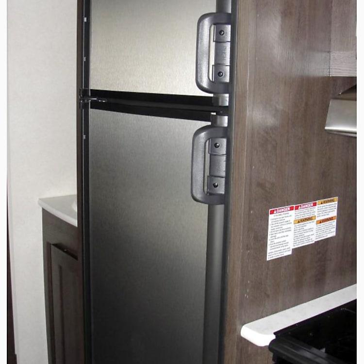 Large gas refrigerator and freezer.