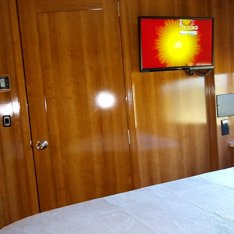 Television inside Queen bedroom.