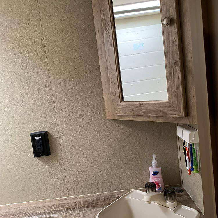 Bathroom cabinet with mirror over vanity.