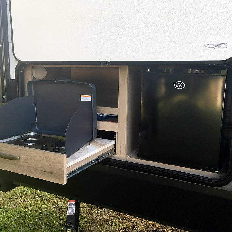 Outdoor kitchen is perfect for easy to cook over fire meals and drink station