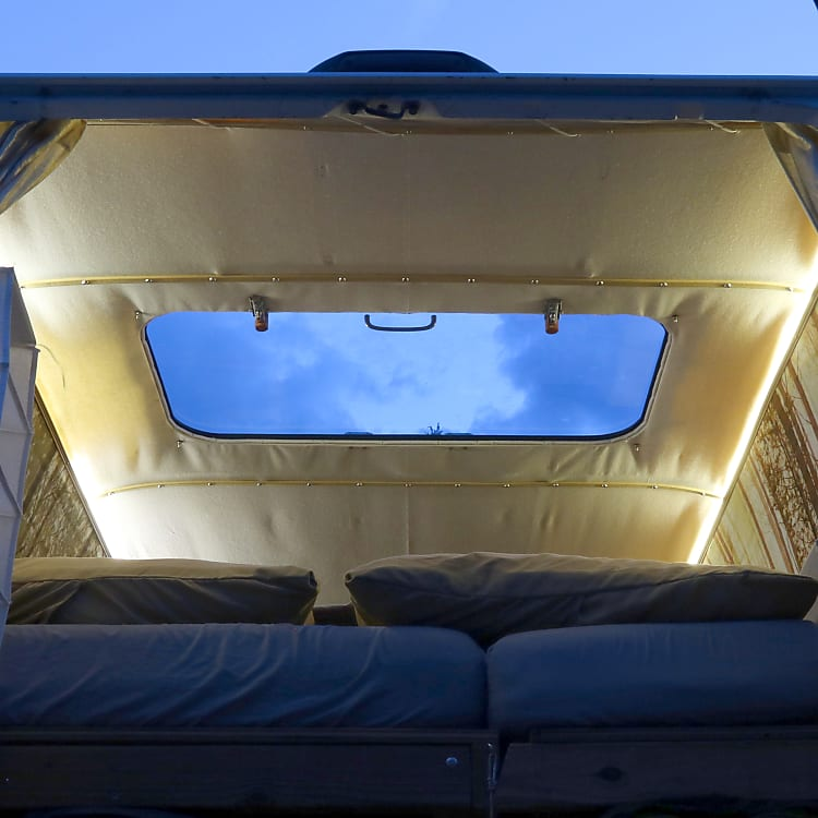 Watch the stars at night through a giant custom built skylight. Sunshade included so you can sleep in.