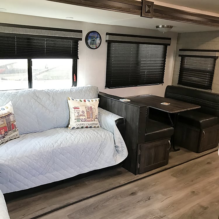 Living/Dining Area w/Table that turns into a bed