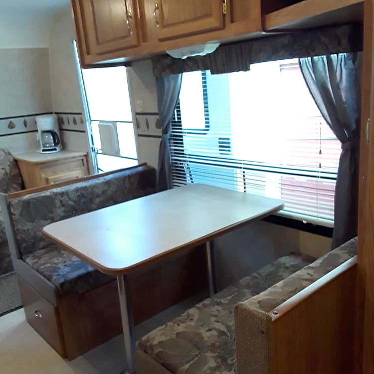Dinette easily folds down into a bed. TV and storage space. Great natural light.
