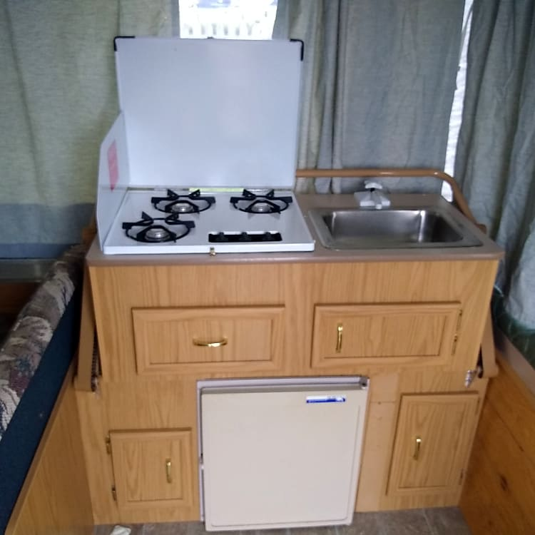 Kitchen Stove, Sink, and Refrigerator