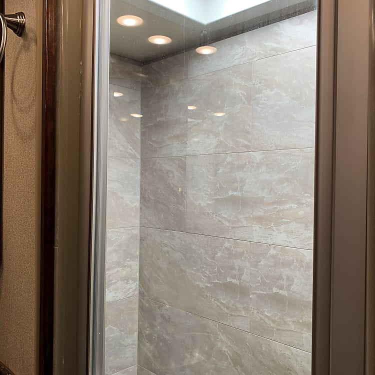Rear luxury tile shower in one of the two full baths