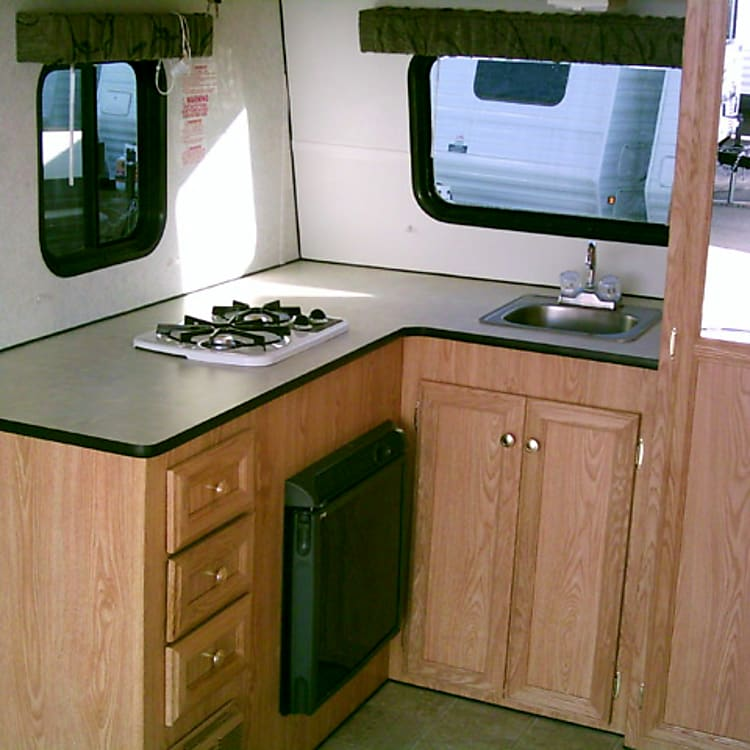 Propane stove and refrigerator that runs on shore power or of the batterys on board.