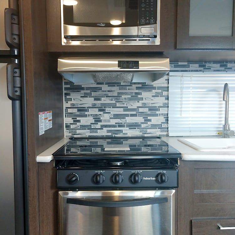 Microwave, vent hood, kitchen window