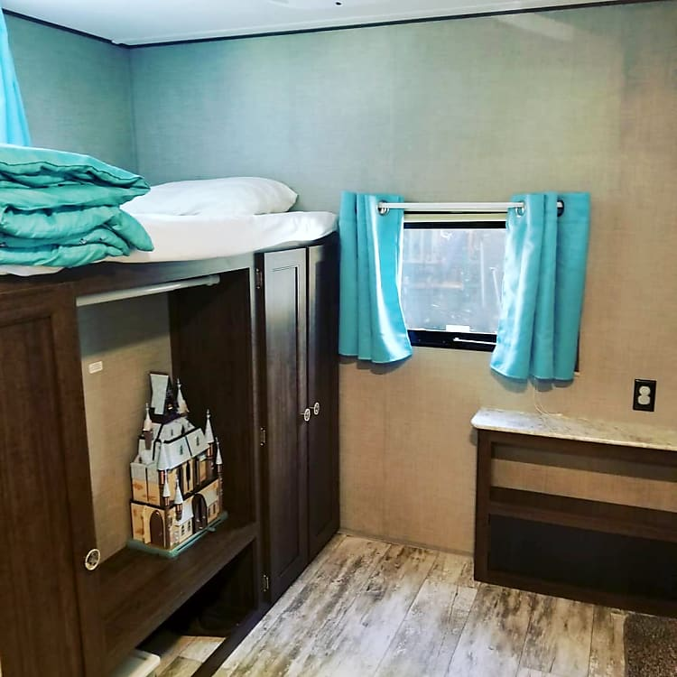 Bunk room features 2 twin bunks, jackknife couch that turns into a bed,  and twin trundle. Ideal for kids.