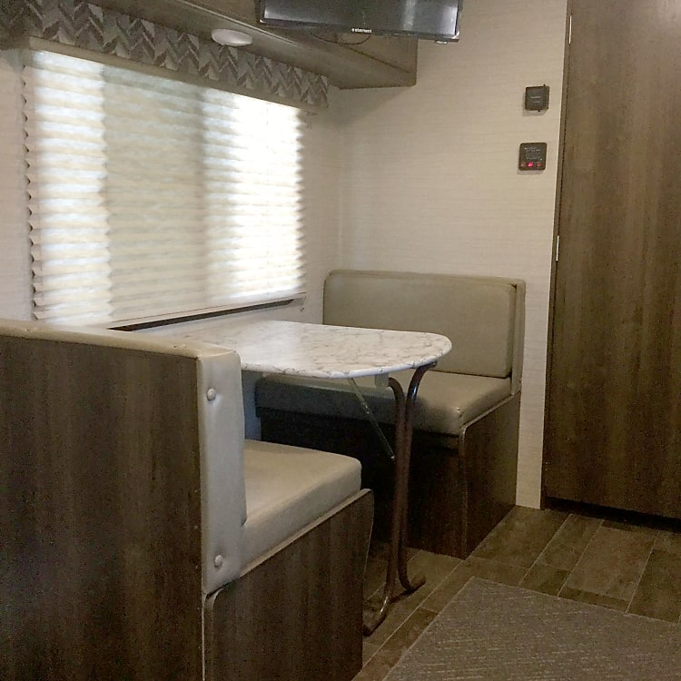 Dinette folds down to make extra bed.