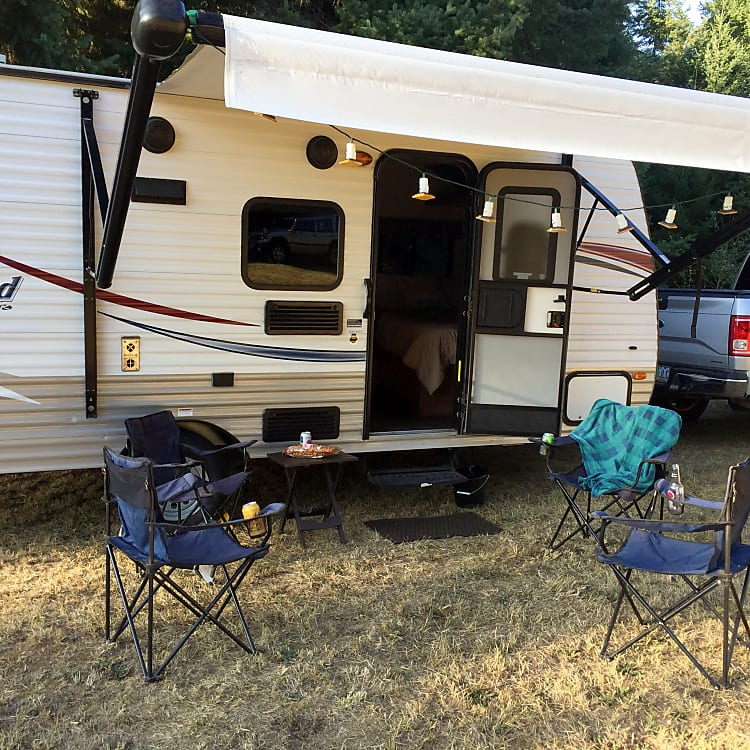 Enjoy the great outdoors - no matter the weather w/awning, camp chairs and cozy blankets.