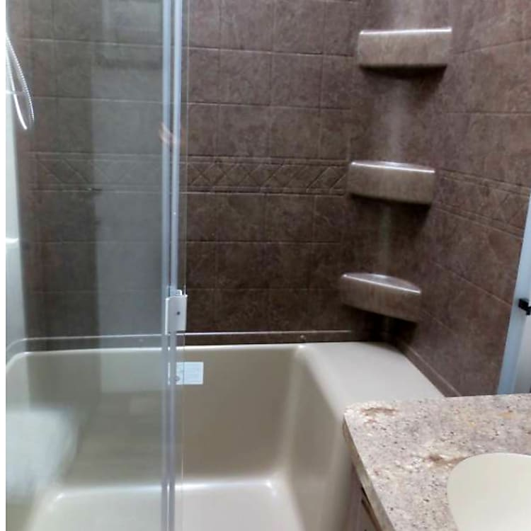 Adult size shower with a 10 gallon water heater.