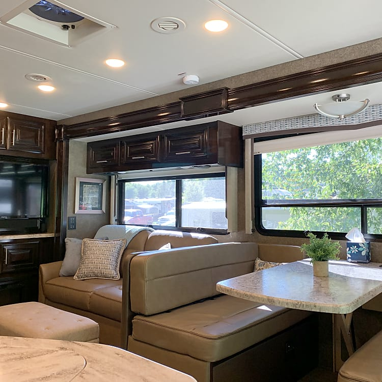 Dinette area and sofa fold down into beds within seconds.  Very easy to operate when you're ready to retire for the day.