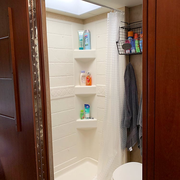 The shower is all you could need to hose off a day of fun! The water gets nice and hot and the shower curtain provides privacy without being too containing.
