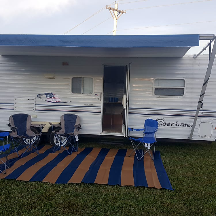 2003 Coachmen 24' Area mat and chair. Two adult chairs and two kid chairs included.