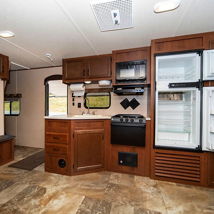Extra roomy kitchen with microwave and large refrigerator!  Comes with dishes, pots/pans, and silverware.