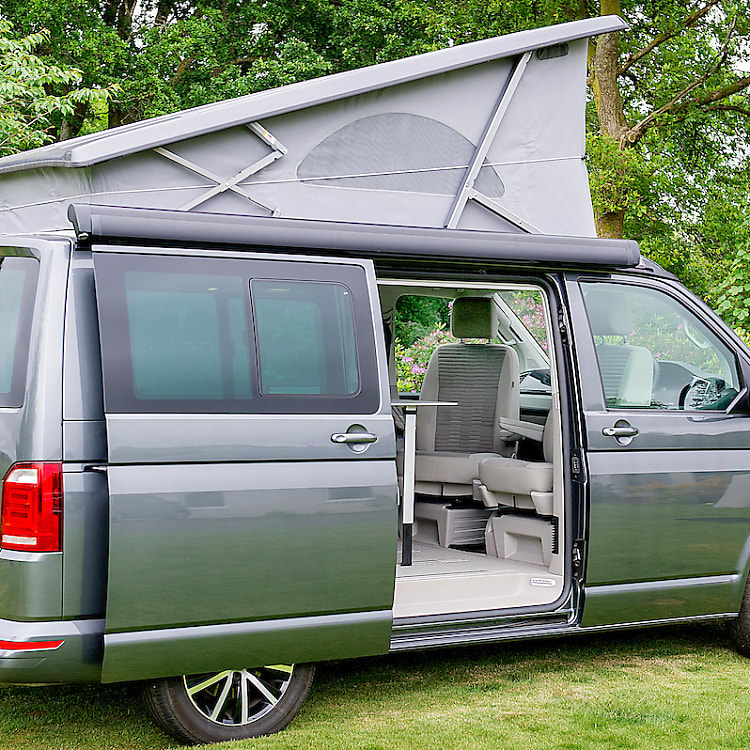Our VW California Ocean has a sliding door on the driver side and a pop up roof housing a second double bed