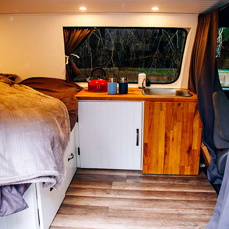 Front of interior of the van showing the kitchen area