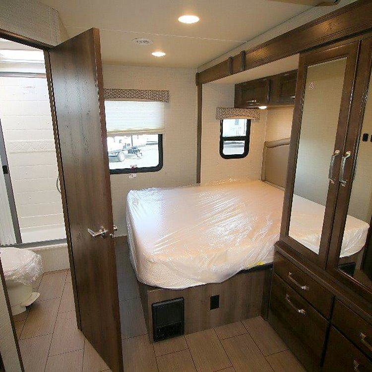 Bedroom includes a pull down privacy divider