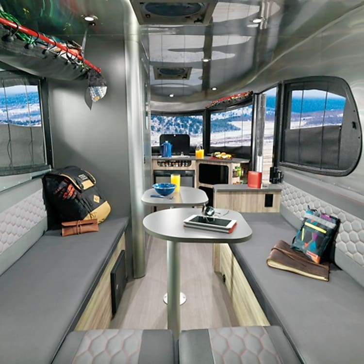 Dining area seats up to 6 and easily converts to a queen size bed. Your Basecamp is the life of the party