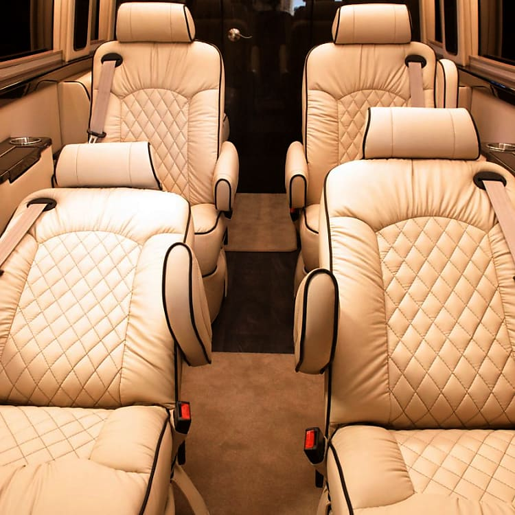 Captains chairs recline and have powered foot rest