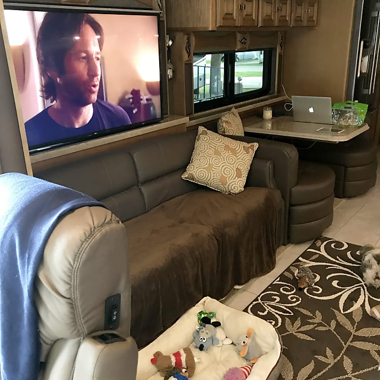 4 Large TV's in Den, Bedroom, Outside and above Driver seat couch opens up to a bed
