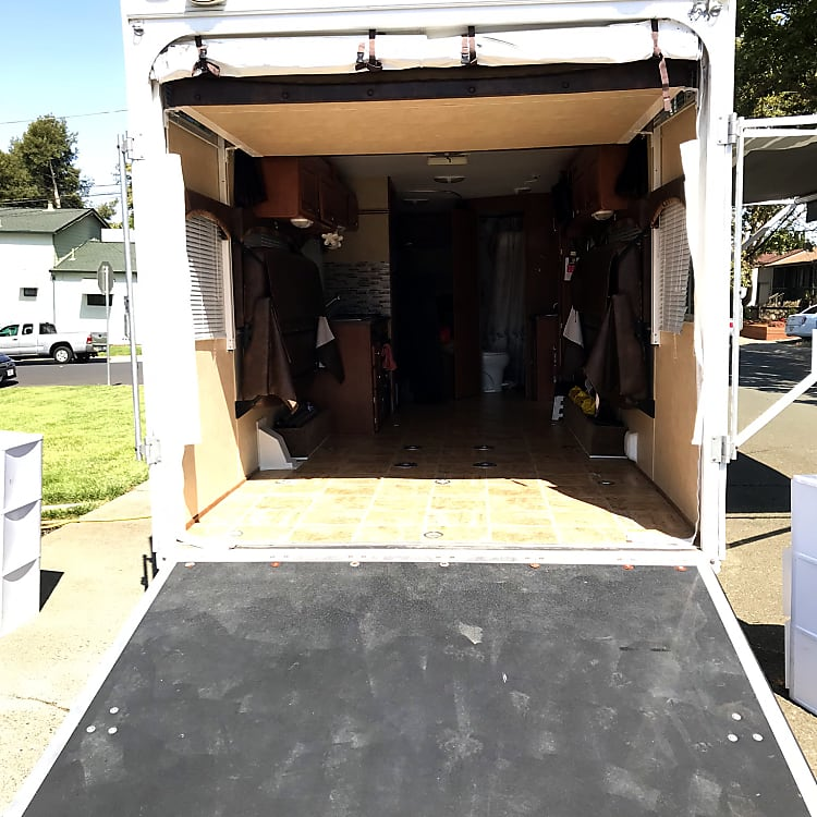Easy rear access for powered scooters, quads and other types of motorsports vehicles. Rear door can become a small patio area.