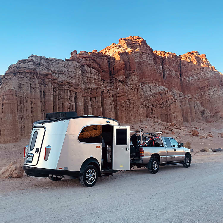 This RV almost looks as good as its surroundings.