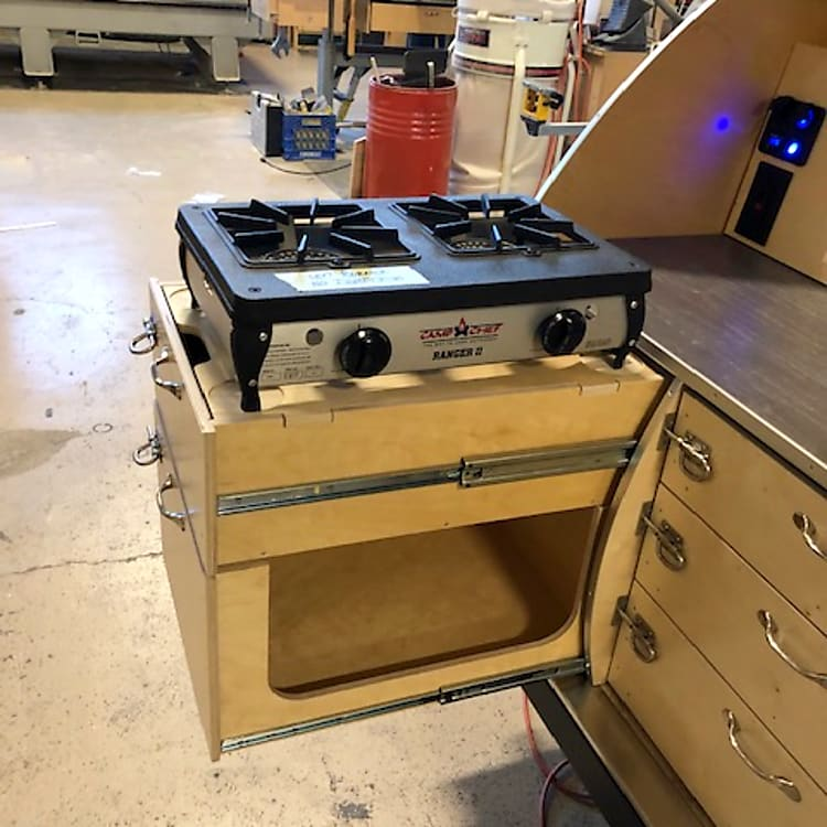 We offer a two drawer stove stack with a Ranger II stove and access to the storage below if you are already in cook mode.
