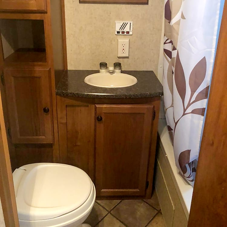 The RV provides ample room for your comfort needs with a full bathroom which includes a tub/shower combo.