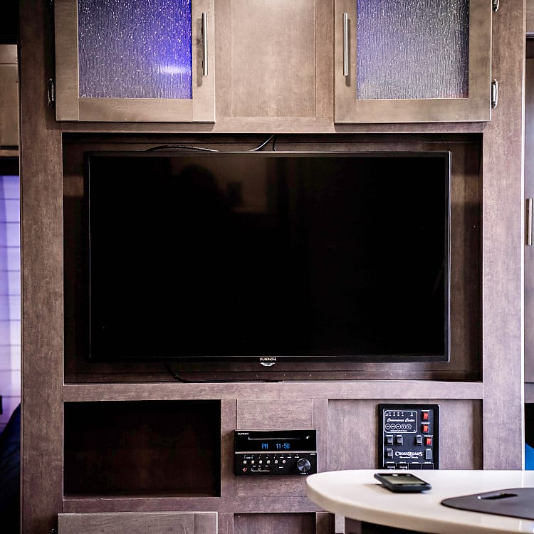 TV in main area hinges for great viewing on couch or at the table