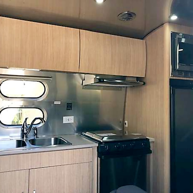 Kitchen with dual sink, range, oven, fridge, microwave and much more