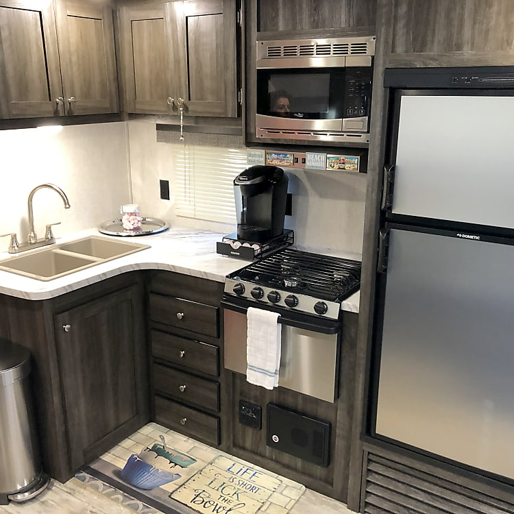 Full kitchen includes a dual sink, microwave, 3 burner stove with oven and a good sized refrigerator!