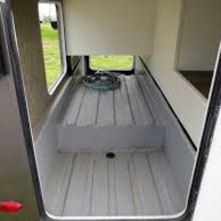 Huge rear exterior storage. Also, there are other external storage compartments for camp chairs, gear, etc.