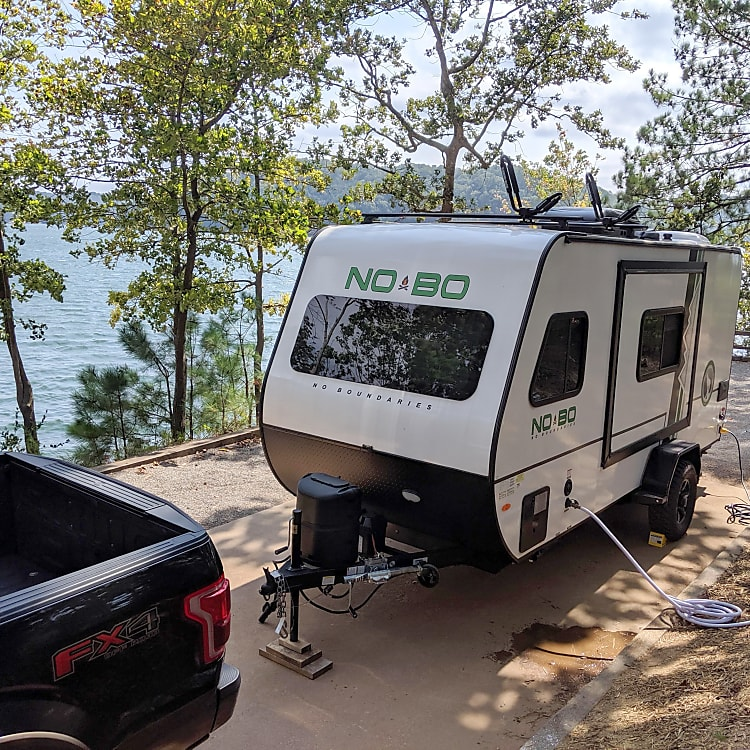 The NOBO 16.8 has the same width as most standard vehicles. This photo gives you an idea of the body width before the slide is extended. Makes towing EASY.