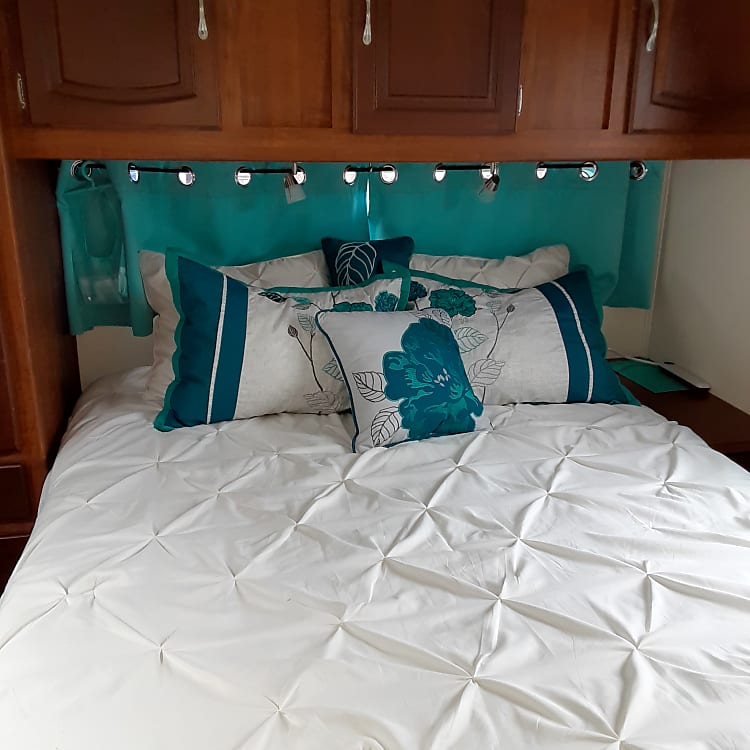 Queen bed in the master with new, deep mattress for extra comfort!