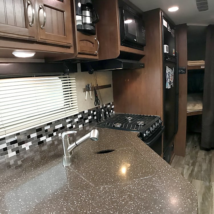 Solid surface counters with glass backsplash