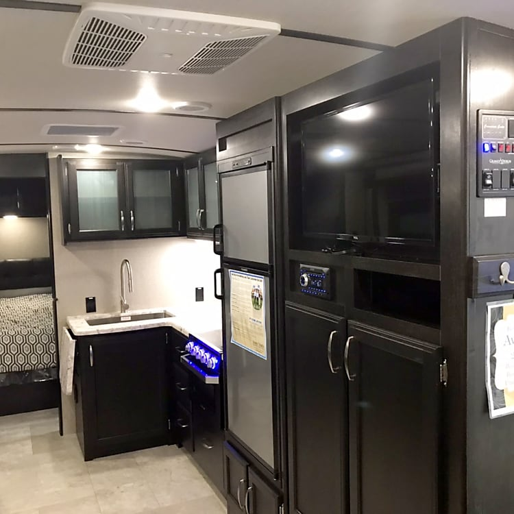 Gas oven, stove, microwave and large fridge/freezer.