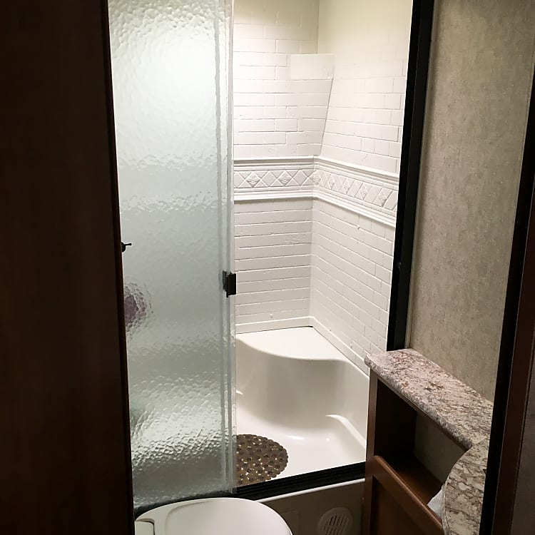 Partial view of bathroom showing full walk in shower