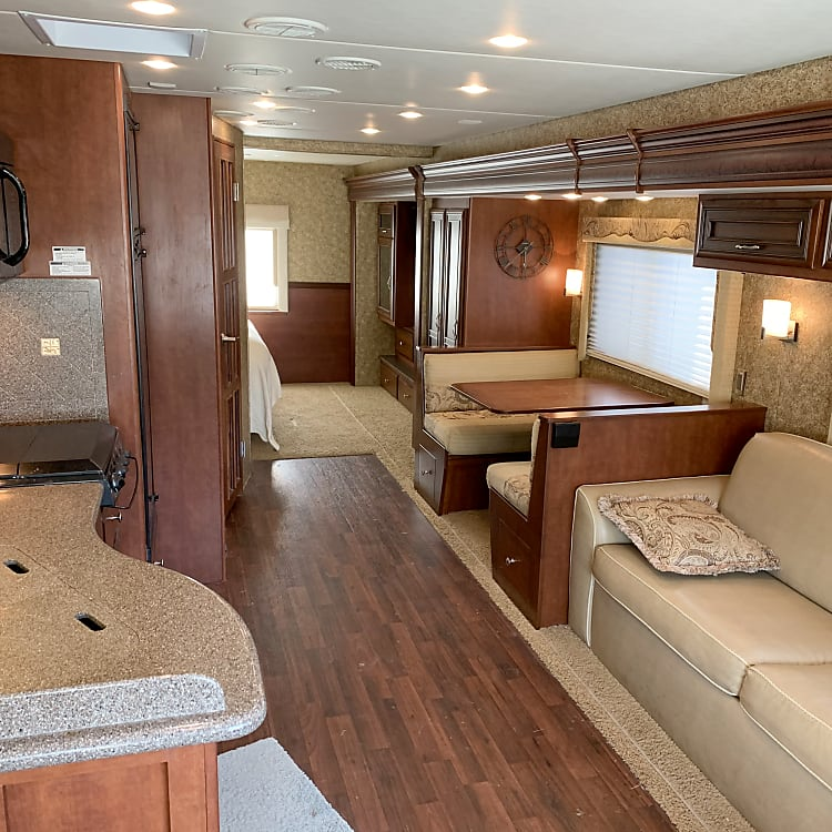 """entry looking toward the rear.  dining table folds down and converts area to a 69"""" x 37"""" bed (children)"""