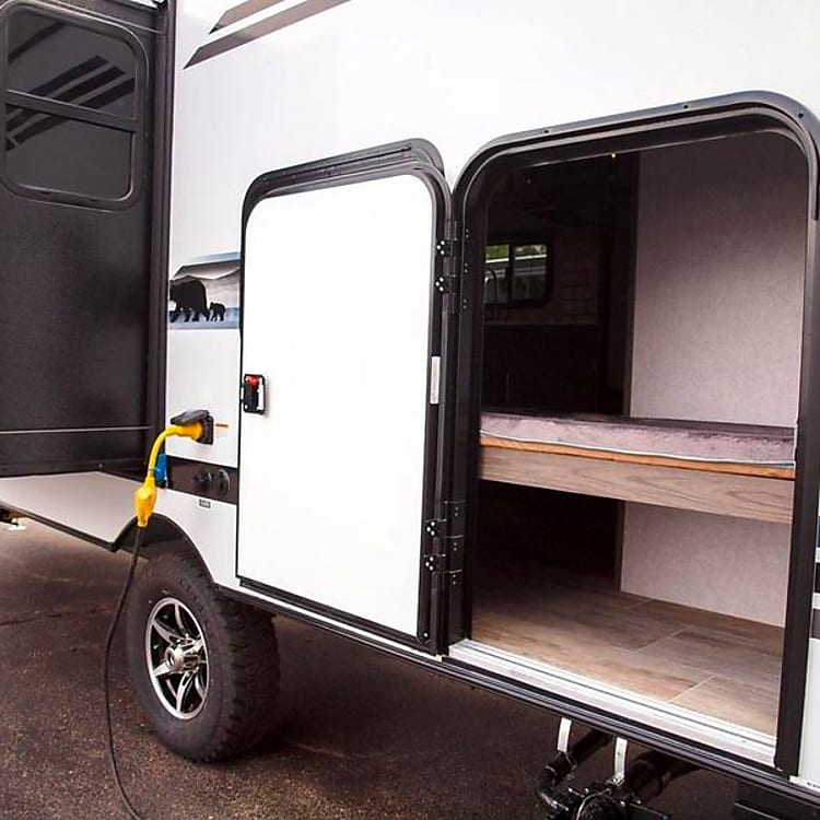 Access door by bunk beds.  These beds fold up to allow for storage of larger items.