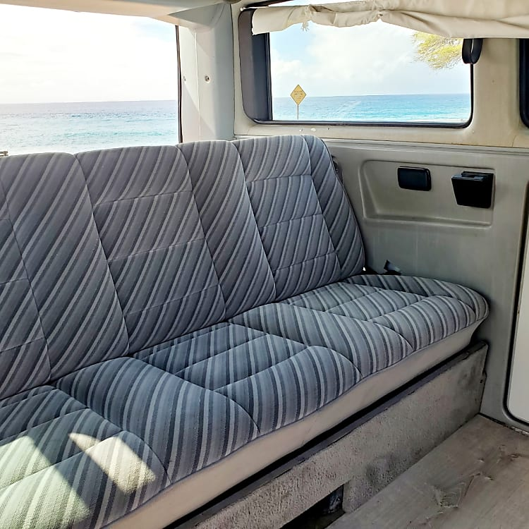Back seat folds down into a bed, or keep it up for 3 seats with seatbelts.