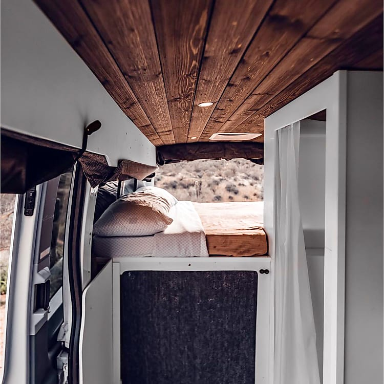Large comfortable bed, distressed barn wood ceiling